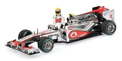 """McLaren MP4/25 """"1º GP. Canadá"""" nº 2 con figura de Lewis Hamilton (2010) Minichamps 1/43"""